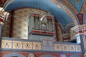 A historic pipe organ in beautiful church poster