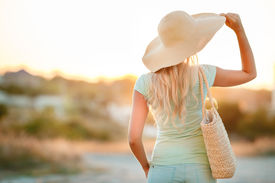 stock photo of big lips  - Blond girl in a big hat in the summer on a sunny summer day - JPG