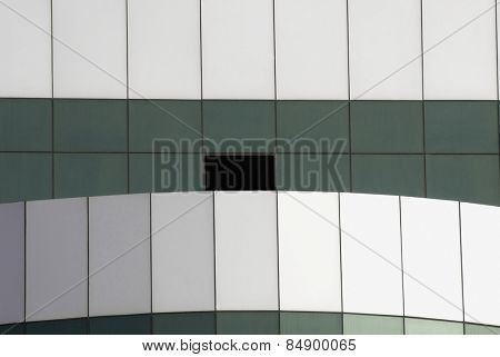 Close-up of an office building with open window in Gurgaon, Haryana, India