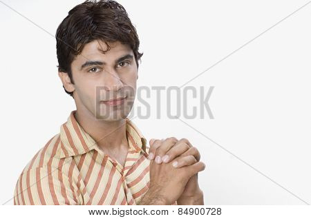 Portrait of a man with his hands clasped