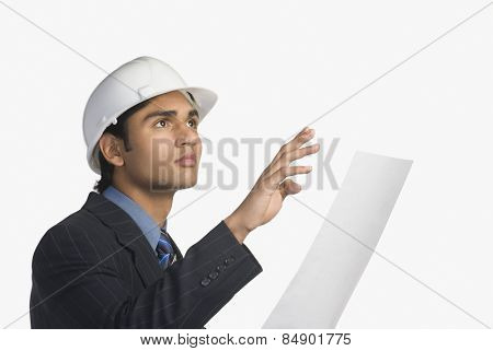 Architect holding a blueprint