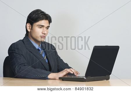 Portrait of a young businessman working