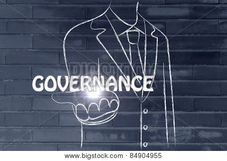 Business Man Handing Out The Word Governance