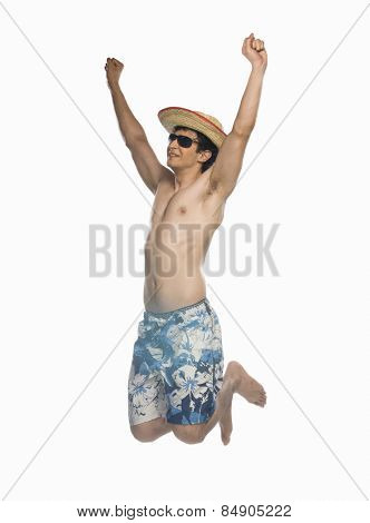 Man jumping against white background