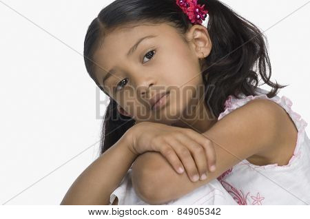 Close-up of a sad girl with her arms crossed