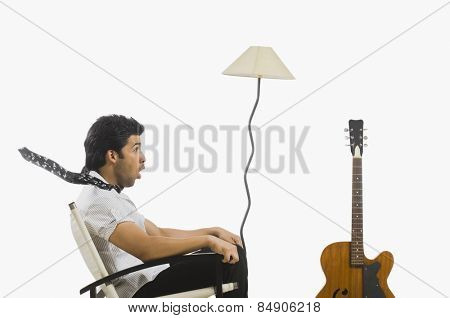 Man sitting in a chair and looking surprised