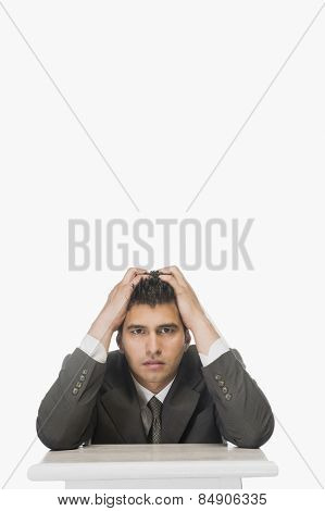 Portrait of a businessman with his head in hands