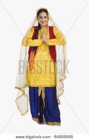 Woman in traditional Punjabi dress greeting