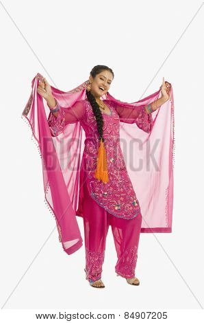 Portrait of a woman dancing in salwar kameez