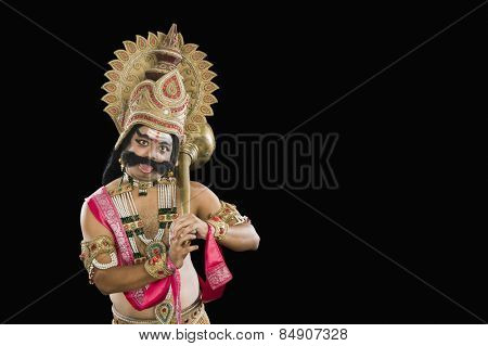 Portrait of a man dressed-up as Ravana and sticking his tongue out