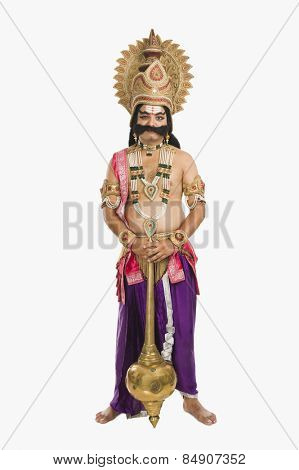 Portrait of a stage artist dressed-up as Ravana the Hindu mythological character and holding a mace