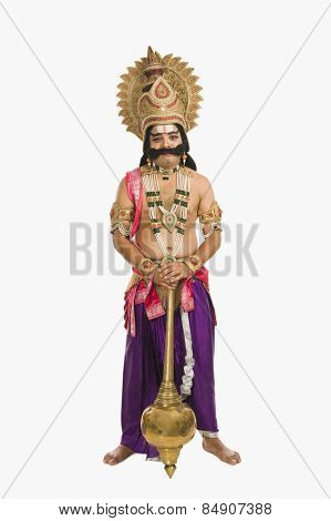 Portrait of a man dressed-up as Ravana the Hindu mythological character and holding a mace