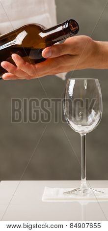 Man Waiter Pouring Wine Into Glass.