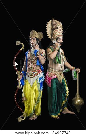 Two actors dressed-up as Rama and Ravana and on call