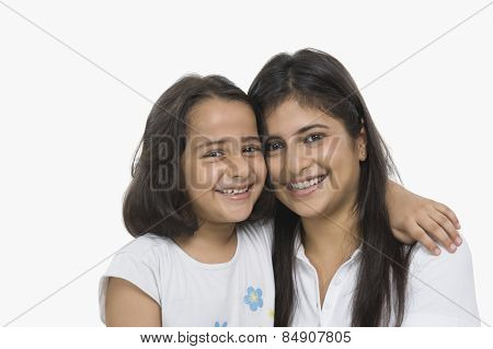 Woman hugging her daughter and smiling