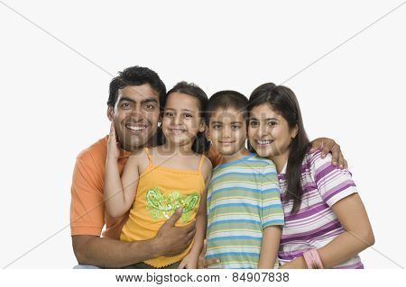 Happy parents with their children smiling