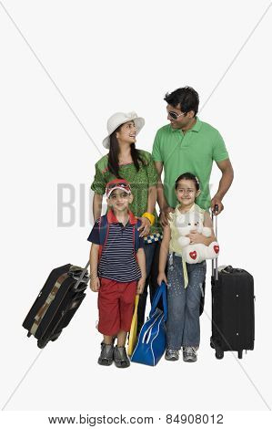 Family going for vacations and smiling