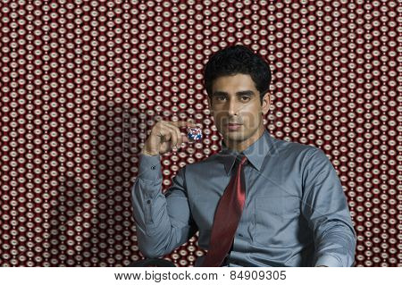 Portrait of a man holding tokens