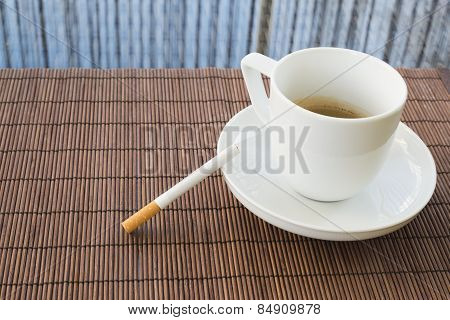 Cup of coffee and cigarette composition