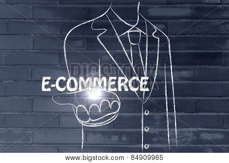 Business Man Handing Out The Word E-commerce