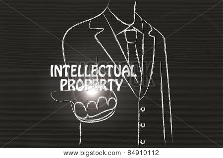 Business Man Handing Out The Word Intellectual Property