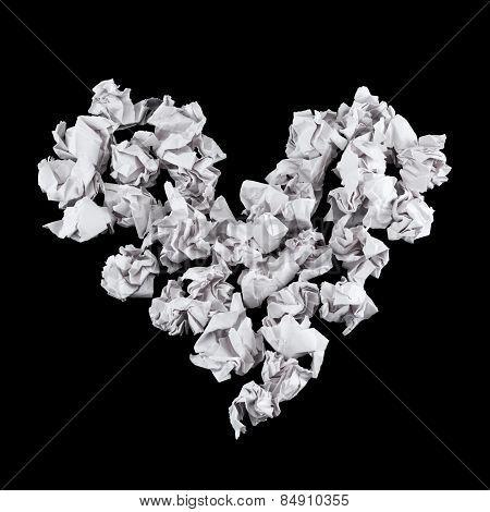 Heart shape made of crumpled paper balls