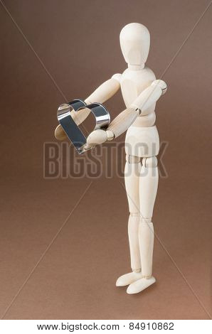 Artist's figure holding a pastry cutter