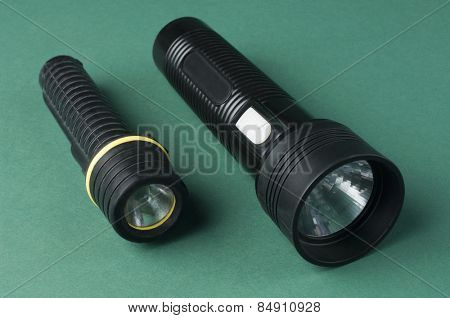 Close-up of two flashlights