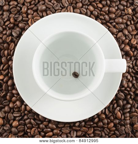 Ceramic cup with one coffee bean
