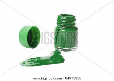 Color spilled from a green watercolor bottle
