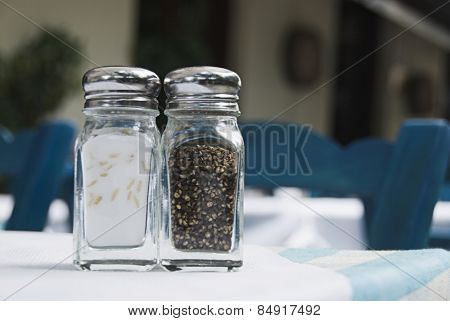 Salt shaker and a pepper shaker on a table, Athens, Greece
