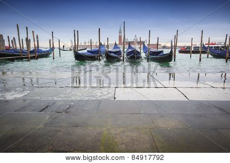 Gondolas Moored In Front Of Pavement