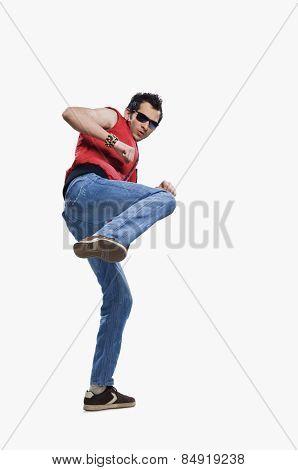 Close-up of a man kicking