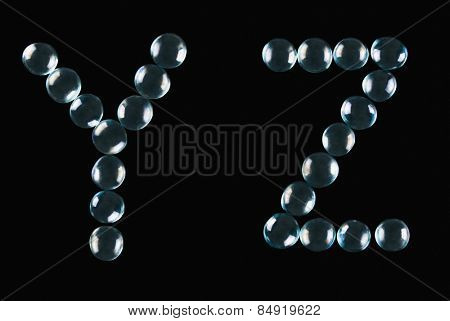 Close-up of marble balls arranged in the shape of letter Y and Z