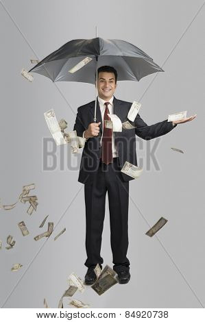 Money raining over a businessman
