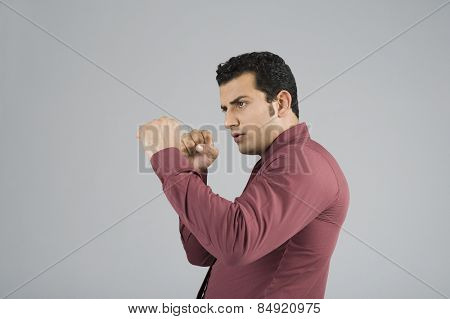 Businessman in boxing pose