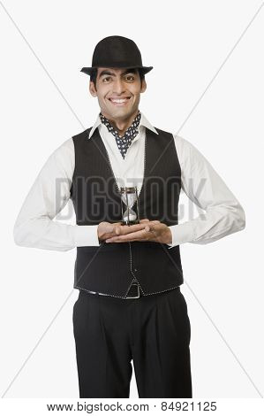 Portrait of a businessman holding an hourglass