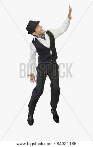 Businessman showing stop gesture and smiling