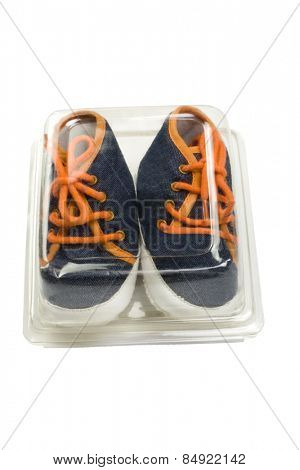 Close-up of a pair canvas shoes in a box