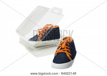 Close-up of a pair of canvas shoes with an open shoe box