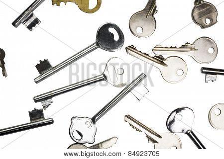 Assorted keys on white background