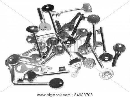 Heap of keys on white background