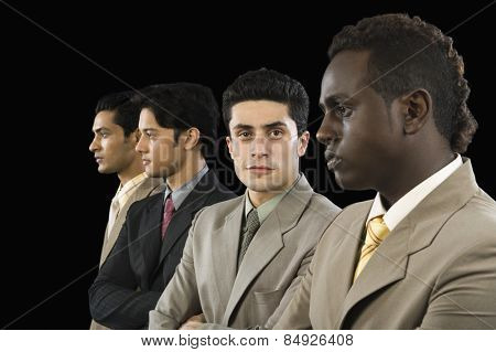 Portrait of a businessman standing with his colleagues