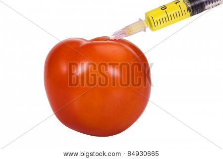 Tomato being injected with a syringe