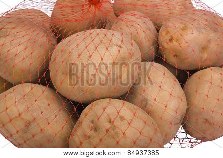 Close-up of raw potatoes in a net bag