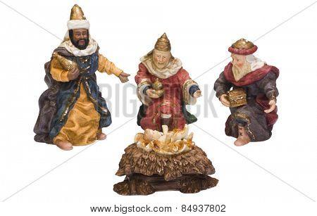 Figurines of kings near baby Jesus