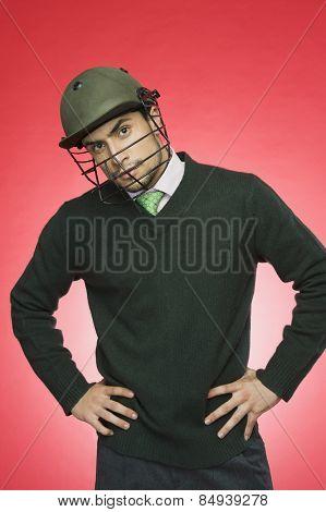 Businessman wearing a cricket helmet