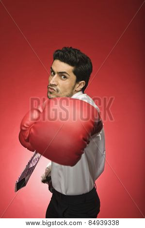 Portrait of a businessman wearing boxing glove