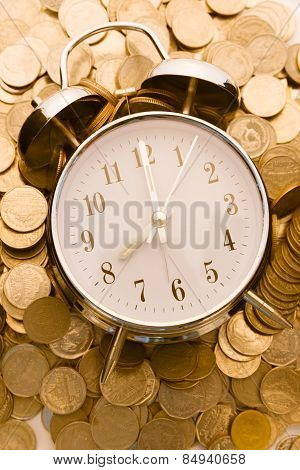 Beautiful Old Clock Staying On One Golden Coins Background. Time Is Money Concept