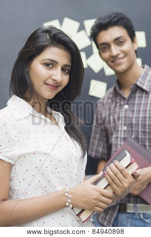 Portrait of a female college student smiling with her friend